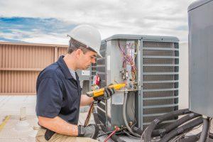 repair man fixing an air conditioner